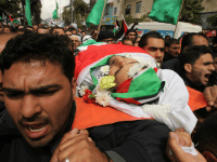 Mourners carry the body of Qassem Abu Ouda, a Palestinian who was shot dead following reported attacks on Israelis, during his funeral on March 15, 2016 in the West Bank town of Hebron.