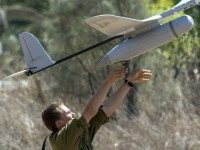 An Israel soldier prepares to launch an Israeli army's Skylark I unmanned drone aircraft, which is used for monitoring purposes on July 14, 2014 at an army deployment area near Israel's border with the Gaza Strip.