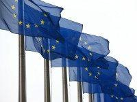 European Union flags are pictured outside the European Commission building on October 24, 2014 in Brussels, Belgium.