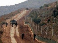 Israeli soldiers patrol the Israeli-Lebanese border at the blue line near the southern Lebanese village of Adaiseh on January 7, 2009.