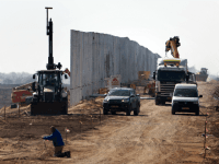 Israeli workers erect a new fence along Israel's border with Jordan in the Arabah valley, some 30 Kilometres north to the southern Israeli resort city of Eilat, on February 1, 2016.