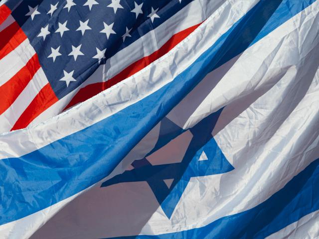 US and Israeli flags are seen as US Secretary of State John Kerry arrives in the Israeli coastal city of Tel Aviv on November 24, 2015