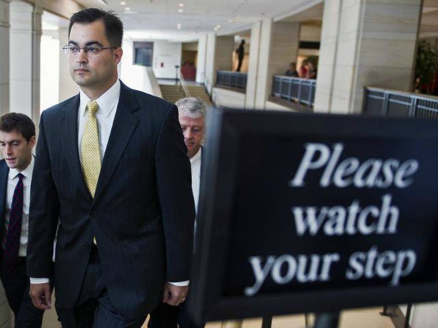 Bryan Pagliano, a former State Department employee who helped set up and maintain a private email server used by Hillary Rodham Clinton, departs Capitol Hill in Washington, Thursday, Sept. 10, 2015, to give his deposition to a House panel on the Benghazi investigation. Pagliano will assert his constitutional right not to testify before any congressional committees, his lawyer says. (AP Photo/Cliff Owen)