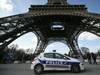 A police car is parked near the Eiffel tower, on March 22, 2016 in Paris.