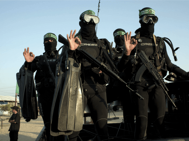 Palestinian youth pose for a picture during a military-style camp organized by the Hamas movement in Rafah in the southern Gaza Strip, on August 1, 2015.