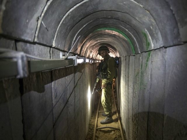 An Israeli army officer walks on July 25, 2014 during an army-organised tour in a tunnel said to be used by Palestinian militants from the Gaza Strip for cross-border attacks