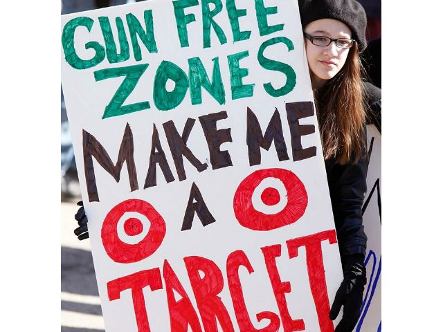 Emma Solorzano, 13, of Jefferson, holds a sign saying Gun Free Zones Make Me a Target at a rally protesting gun control legislation and supporting gun rights in Wiscasset on Saturday, March 9, 2013, About 175 people attended the rally, which was organized by Jessica Beckwith of Lewiston, who is forming the Maine Gun Rights Coalition. (Photo by Gregory Rec/Portland Press Herald via Getty Images)