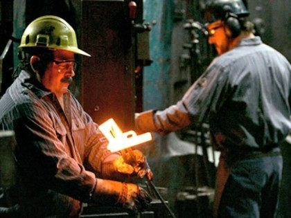 Workers inspect hot metal forgings of model 1911 handguns on the production line at the Smith & Wesson factory in Springfield, Tuesday, Dec. 19, 2006. Mike Golden, Smith & Wesson's CEO for the past two years, has targeted new technologies and sales to the military and police departments to ensure …