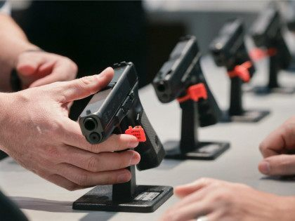 FILE - In this Wednesday, Jan. 16, 2013 file photo, a Glock representative explains features of the Glock 37 Gen 4 .45 caliber pistol at the 35th annual SHOT Show, in Las Vegas. After struggling to sway both state and federal lawmakers, proponents of expanding background checks for gun sales …