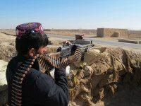 AFGHANISTAN, HELMAND : An Afghan Local Police (ALP) personnel keeps watch during an ongoing battle with Taliban militants in the Marjah district of Helmand Province on December 23, 2015. Military planes have dropped food and ammunition to besieged Afghan forces battling to push Taliban insurgents out of Sangin, officials said …