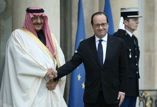 French President Francois Hollande (right) greets Saudi Crown Prince Mohammed bin Nayef at the Elysee Palace in Paris, on March 4, 2016