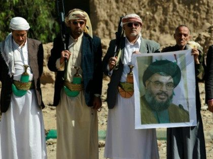 Huthi militiamen hold posters depicting Lebanon's Hezbollah chief Hassan Nasrallah during a gathering to show their support to Hezbollah following the Gulf states' announcement declaring the group a ' terrorist organization', in the capital Sanaa, on March 3, 2016. Gulf monarchies on March 2 declared Lebanon's Hezbollah a 'terrorist' group, …