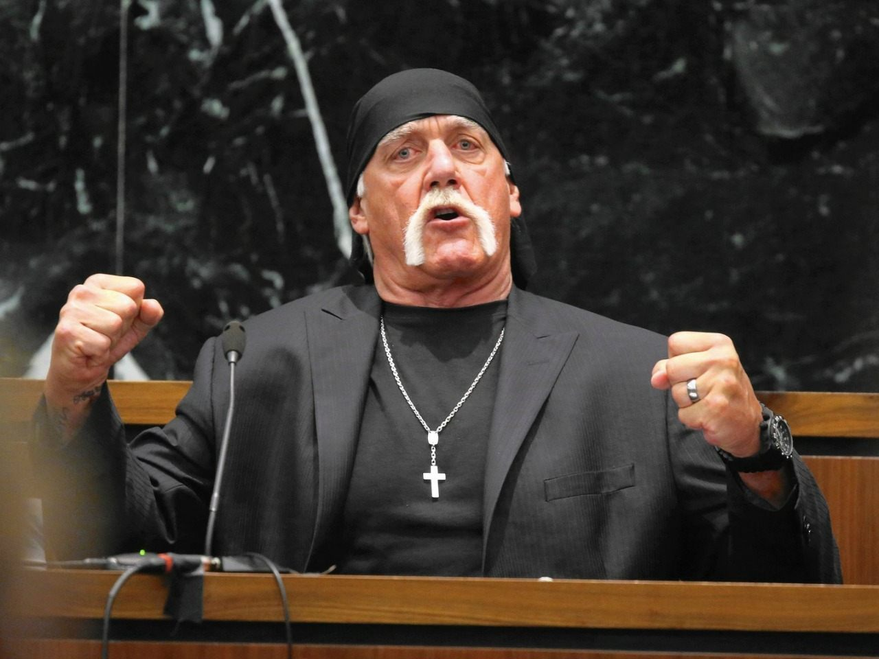 Hulk Hogan, whose given name is Terry Bollea, testifies in court on Tuesday, March 8, 2016, during his trial against Gawker Media, in St Petersburg, Fla. Hogan and his attorneys are suing Gawker for $100 million, saying that his privacy was violated, and he suffered emotional distress after Gawker posted a sex tape filmed of Hogan and his then-best friend's wife. (John Pendygraft/Tampa Bay Times via AP, Pool)
