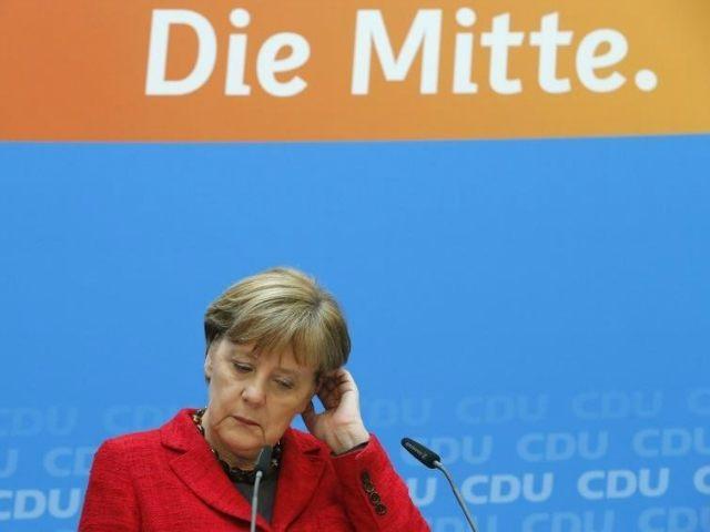 BERLIN (Reuters) - German Chancellor Angela Merkel's Christian Democrats agreed …