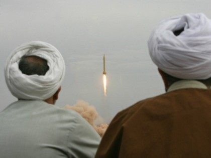 ranian clergymen watch a Shahab-3 long-range ballistic missile fird by Iran's Revolutionary Guards in the desert outside the holy city of Qom, 02 November 2006.