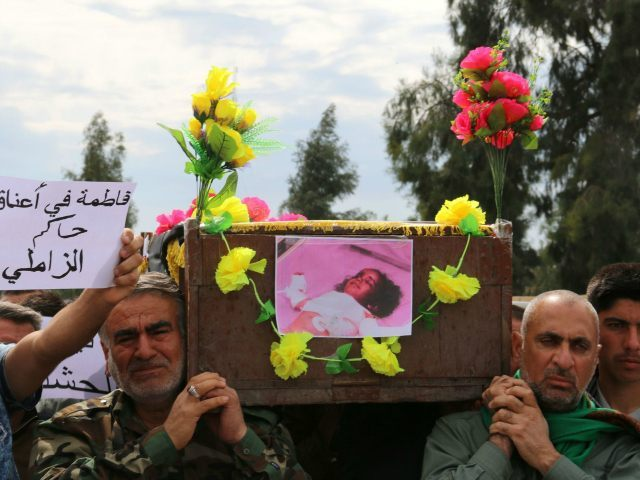 Iraqi Sameer Wais (R) carries the coffin of his three-year-old daughter, Fatima, who was killed following a chemical attack by the Islamic State (IS) group against the town of Taza, south of Kirkuk, during her funeral on March 11, 2016. Seventeen residents of the town of Taza were being treated …