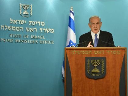 In this handout provided by the Israeli Government Press Office, Israel Prime Minister Benjamin Netanyahu (R) delivers a statement to the press on April 3, 2015 in Jerusalem, Israel. Netanyahu delivered a speach discussing a pending nuclear deal with Iran.