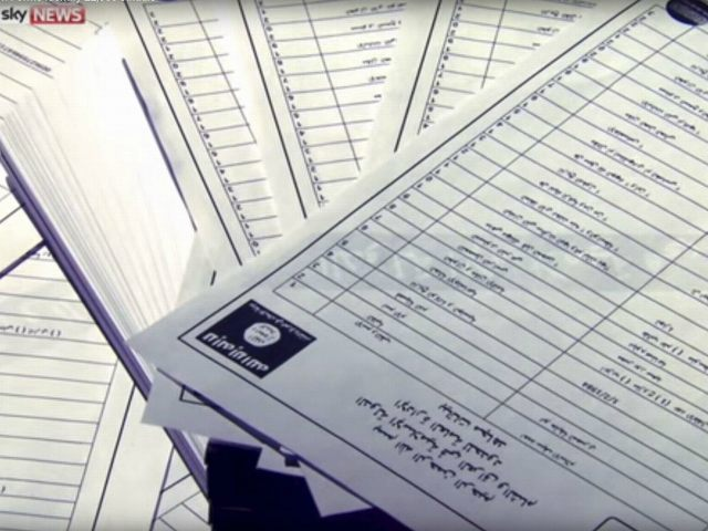 Documents identifying supporters of Islamic State are seen in this still image from video, released by Sky News to Reuters in London on March 10, 2016. REUTERS/SKY NEWS/HANDOUT VIA REUTERS