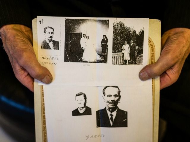 Picture taken on March 16, 2016 in Nowy Sacz, Poland, shows Jozef Jarosz presenting old pictures of Jews he and his family helped to survive the Holocaust, and of his parents, his mother (down L) and his father Franciszek Jarosz. Jozef Jarosz and his father Franciszek helped Anna Grygiel and …