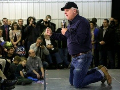 American television personality and radio host Glenn Beck talks from his knees about Republican presidential candidate Ted Cruz during a campaign event at the Johnson County Fairgrounds January 31, 2016 inIowa City, Iowa.
