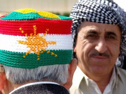 Kurdish man wears a knitted hat with the Kurdish national flag during a memorial festival for the late Sheikh Mahmood Alhafeed, in the northern Kurdish city of Arbil, 11 April 2006