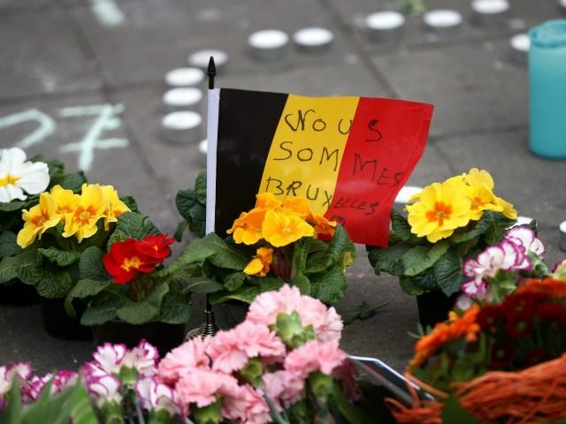 Tributes are left at the Place de la Bourse following today's attacks on March 22, 2016 in Brussels, Belgium. At least 31 people are thought to have been killed after Brussels airport and a Metro station were targeted by explosions.