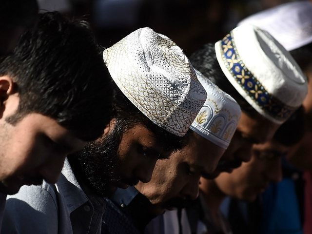 MALAYSIA, Kuala Lumpur : Muslim men offer Eid al-Fitr prayers on a street in Kuala Lumpur on July 17, 2015. Eid al-Fitr festival marks the end of the holy Muslim fasting month of Ramadan. AFP PHOTO / MANAN VATSYAYANA