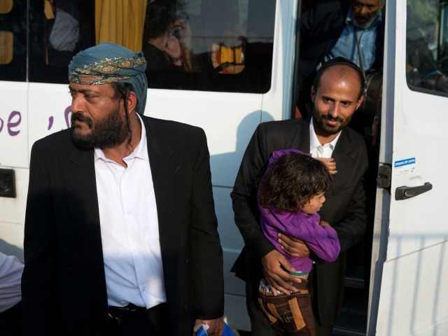 Yemeni Jew, Sliman Ychya Yakov Dahari (L), arrives alongside other Yemeni Jews to an immigration centre in the Israeli city of Beersheba on March 21, 2016 following a secret rescue operation to evacuate a group of 19 Jews from war-torn Yemen to Israel. Israel has spirited 19 Jews out of …