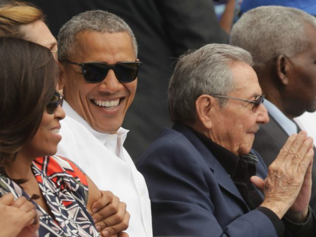 HAVANA, CUBA - MARCH 22: (L-R) U.S. first lady Michelle Obama, President Barack Obama and Cuban President Raul Castro attend an exhibition game between the Cuban national baseball team and Major League Baseball's Tampa Bay Devil Rays at the Estado Latinoamericano March 22, 2016 in Havana, Cuba. This is the first time a sittng president has visited Cuba in 88 years. (Photo by Chip Somodevilla/Getty Images)