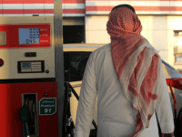 A Saudi man walks past a pump at a petrol station on December 28, 2015 in the Red Sea city of Jeddah. Saudi Arabia said it plans to review the prices of heavily-subsidised power and fuel as part of new measures introduced in the face of low oil prices.