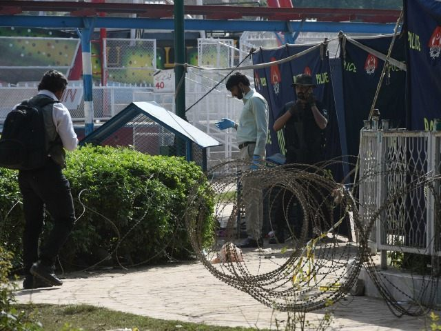 Pakistani investigators collect evidence at a suicide blast site in Lahore on March 28, 2016. A suicide bomber who attacked a park thronging with families celebrating Easter killed at least 72 people in Pakistan, with children among the dead.