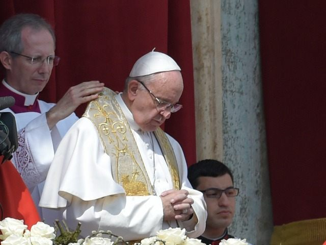 Pope Francis (C) prepares to deliver the 'Urbi et Orbi' blessing for Rome and the world from the central loggia of St Peters' basilica following the Easter Sunday mass on March 27, 2016 at St Peter's square in Vatican.