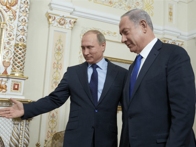 Russian President Vladimir Putin (L) shows the way to Israeli Prime Minister Benjamin Netanyahu during a meeting at the Novo-Ogaryovo residence, outside Moscow, on September 21, 2015.