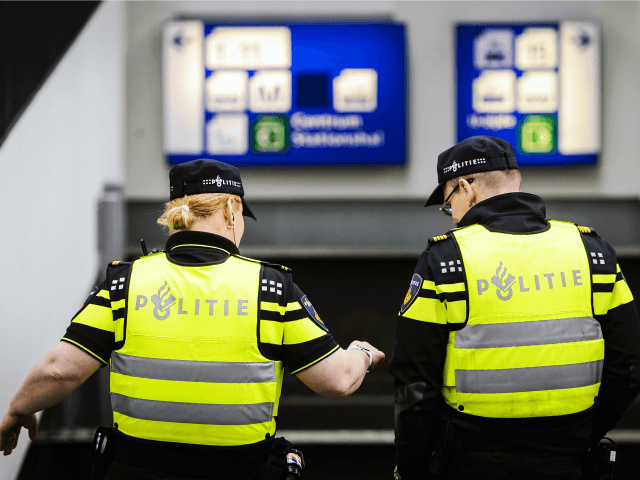 Dutch police officers patrol the Central Station in Amsterdam on March 22, 2016 as security measures were reinforced in the wake of blasts in Brussels. Belgium's neighbours France, Germany and the Netherlands tightened border security after the attacks on Brussels airport and metro system that left at least 26 dead.