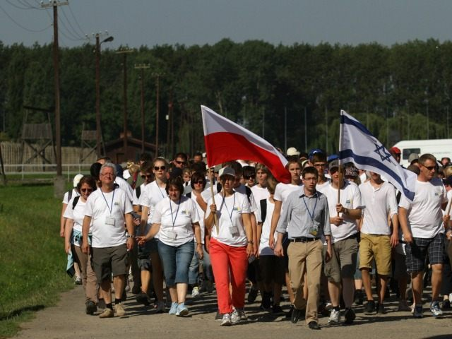 Participants carry Polish, German and Israeli flags, as they take part in the 'March of the living' to commemorate victims of the Auschwitz-Birkenau concentration camps, in Oswiecim on August 20, 2012