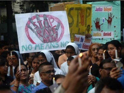 India, Kolkata : Indian Christians and other ndian residents protest against the gang rape of a nun at a Christian missionary school in eastern India as they gather for a silent solidarity rally in Kolkata, India, Monday, March 16, 2015. According to police 71 year old nun was gang-raped by …
