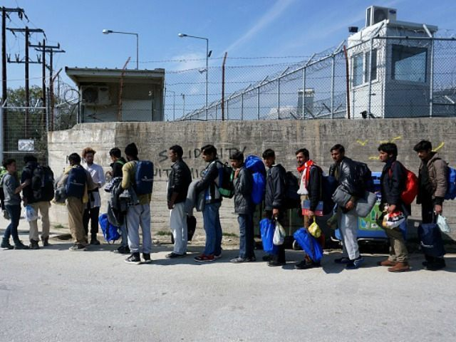 Migrants from Pakistan wait to enter Moria camp for migrants and refugees on the Greek island of Lesbos on March 21, 2016. More than 1,600 migrants have landed in Greece since a landmark EU-Turkish deal on curbing the influx took effect, officials said Monday, highlighting the challenges still facing efforts to tackle the crisis. The EU and Ankara reached an agreement at a summit on Friday aiming to cut off the sea crossing from Turkey to the Greek islands that enabled 850,000 people to pour into Europe last year, many of them fleeing conflict in Syria