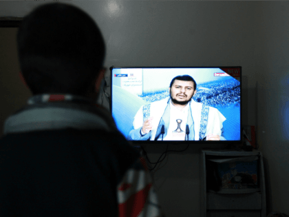 A Yemeni man watches the televised speech of the Shiite Huthi movement's leader Abdul-Malik al-Huthi in the capital Sanaa, after the US ordered the closure of its embassy in the country, on February 10, 2015.