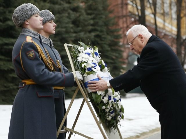 Israeli President Reuven Rivlin attends a wreath-laying ceremony at the Tomb of the Unknown Soldier by the Kremlin Wall in Moscow, on March 16, 2016.