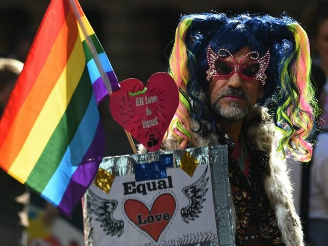 A supporter of same-sex marriage attends a rally in Sydney on August 9, 2015. Thousands of people rallied in Australian cities this weekend in support of same-sex marriage, as politicians across multiple parties prepared to table a bill to make the unions a legal right.