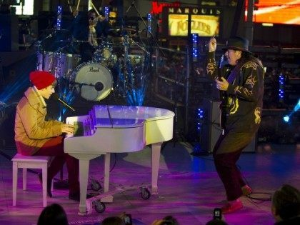 Justin Bieber and Carlos Santana perform during the New Year's Eve celebration in Times Square December 31, 2011 in New York.