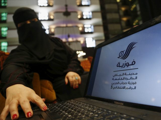 "Saudi woman Fawzia al-Harbi, a candidate for local municipal council elections, shows her candidate biography at a shopping mall in Riyadh November 29, 2015. The biography reads ""Fawzia, Riyadh City, Fifth District, Fawzia Hejab al-Harbi, Electoral Number 3"" REUTERS/Faisal Al Nasser"