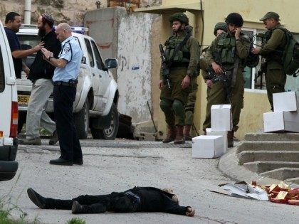 Israeli soldiers and police surround the body of one of two Palestinians who were killed after wounding an Israeli soldier in a knife attack before being shot dead by troops, an army spokeswoman said, at the entrance to the heavily guarded Jewish settler enclave of Tal Rumeda in the city …