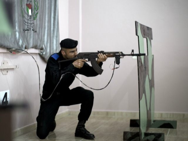 A member of the ruling Hamas security forces aims his rifle during a target shooting session using makeshift laser guns in the police training headquarters of the Hamas authorities in the Gaza City on March 27, 2014.