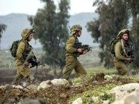 Israeli soldiers from the Golani Brigade take part in a military training exercise in the Israeli-annexed Golan Heights near the border with Syria on January 19, 2015. Iran confirmed today that a general of its elite Revolutionary Guards died in an Israeli strike on Syria that also killed six members …