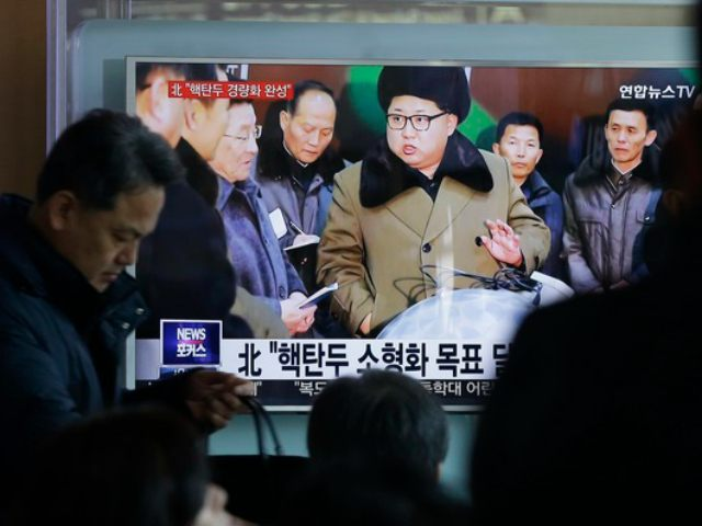 "South Korea -- People watch a TV news program showing North Korean leader Kim Jong Un with superimposed letters that read: ""North Korea has made nuclear warheads small enough to fit on ballistic missiles"" at Seoul Railway Station in Seoul, South Korea , Wednesday, March 9, 2016. The official North …"