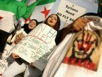 Americans and supporters of the Syrian people gathered to demonstrate against Russia's military build up and action in Syria and its four-year civil war.