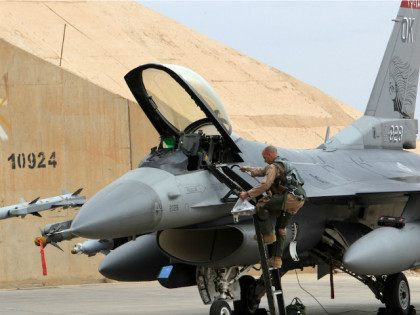 IRAQ, Baghdad : A pilot climbs into a U.S. F-16 jet fighter at the al-Asad Air Base west the capital Baghdad, on November 1, 2011. US soldiers began to leave the base to go home in a massive logistical operation which has to be finished by December 31, in line …