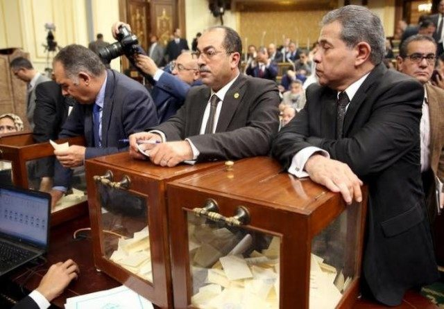 Tawfik Okasha (R), looks onvote to choose the head of the Egypt's Parliament late in Sunday's procedural and opening session at the main headquarters of Parliament in Cairo, Egypt, January 10, 2016. REUTERS/Stringer