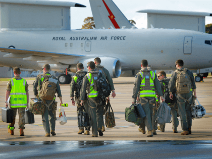 In this handout image provided by Commonwealth of Australia, air crew prepare to board the the E-7A Wedgetail Airborne Early Warning and Control aircraft for deployment to the Middle East on September 21, 2014 in Williamtown, Australia.